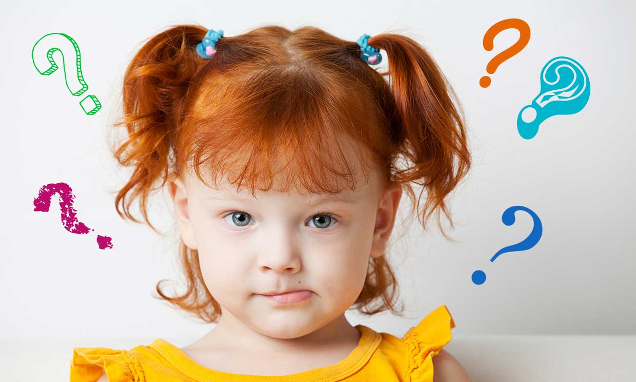 redheaded toddler biting lip with question marks
